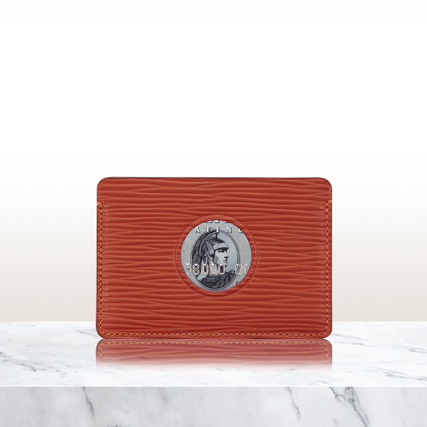 Single Cut Out Card Holder in red leather on marble surface